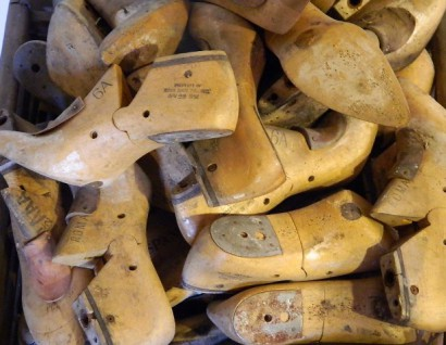 antique hardwood shoe lasts or molds or forms salvaged and reclaimed from a lawrence, massachusetts mill building