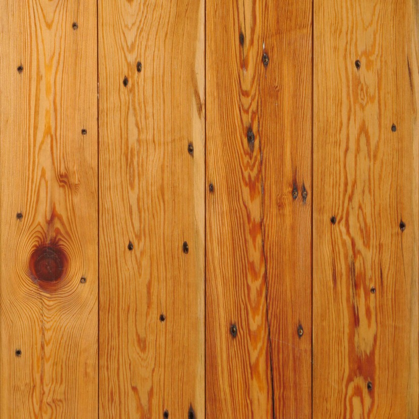 reclaimed naily grade heart pine flooring with nail holes and knots
