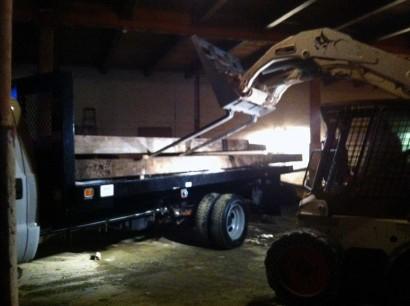 loading reclaimed salvaged antique repurposed heart pine beams from jordan marsh's stable in boston, massachusetts