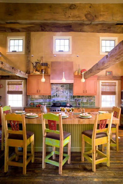 reclaimed salvaged repurposed antique hand hewn beams and teragran bamboo butcher block counter in kitchen