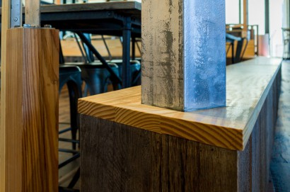 reclaimed salvaged repurposed antique barn board and heart pine flatsawn cabinets and skip-planed oak flooring at the venture cafe in cambridge innovation center in kendall square massachusetts