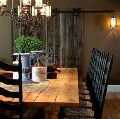 Salvaged Barn Board On Sliding Door and Reclaimed White Oak Table In Private Home