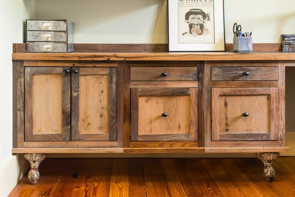 Reclaimed skip-planed oak cabinets by Hawkeye Carpentry.