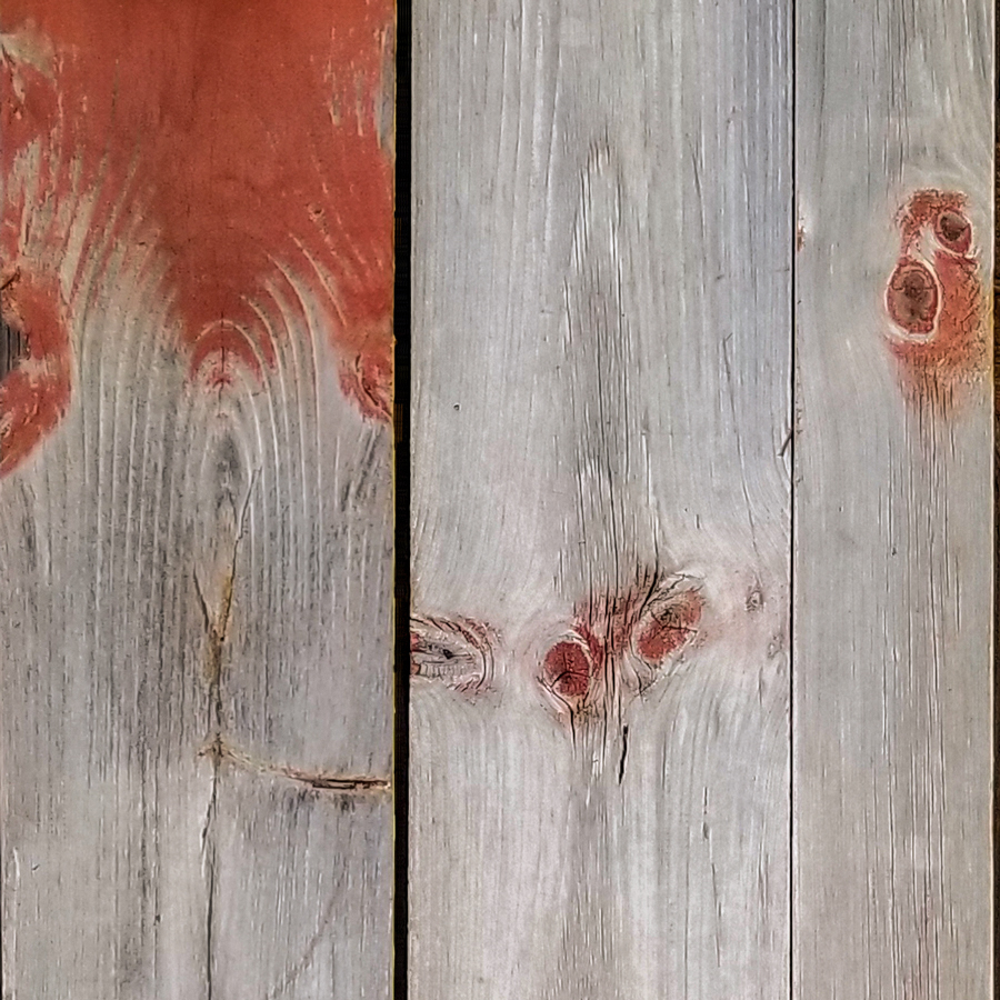 Salvaged barn board with red paint