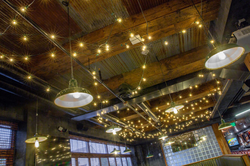 Backyard Betty's Reclaimed Barn Board Beam Cladding and Salvaged Tin Ceiling