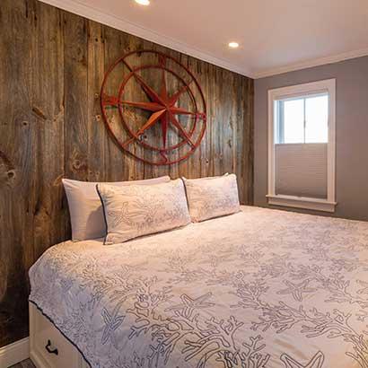 Reclaimed Barn Board On Bedroom Wall