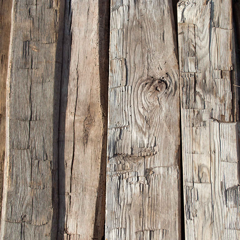 Reclaimed Wood Beams With A Hand-Hewn Surface