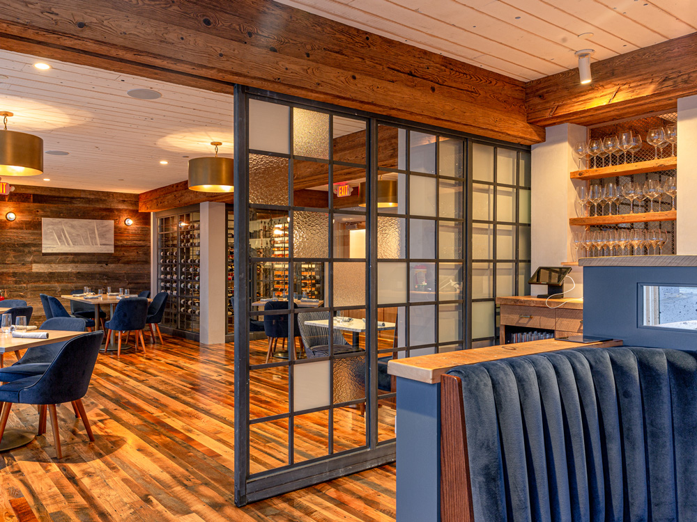 Connecticut Restaurant With Barn Board Paneling, Skip-Planed Oak Flooring, and Mushroom Wood Beam Cladding