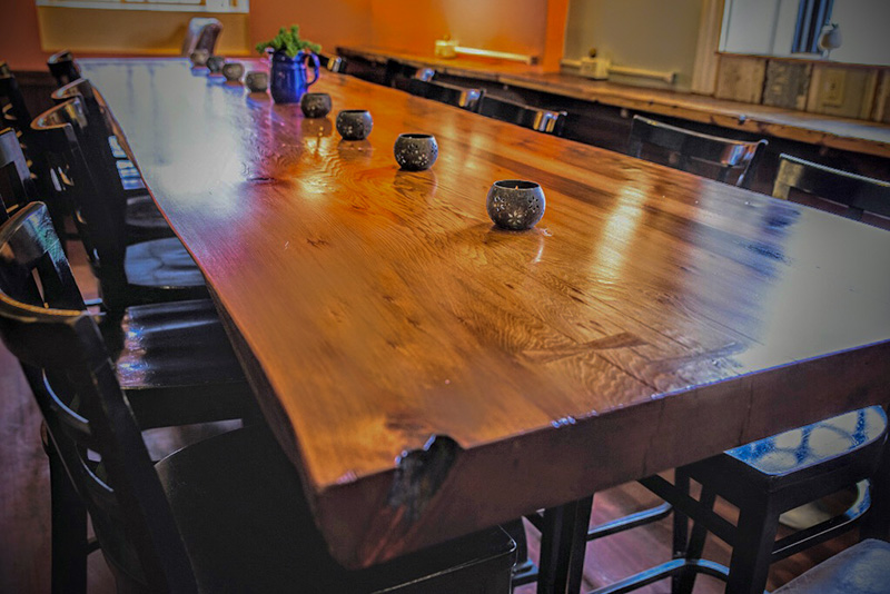 Salvaged redwood table by P. Bevan Builders for Gloucester, MA restaurant