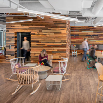 Reclaimed Wood Paneling on Walls and Ceilings in Workspace